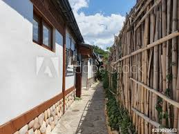 Asian Korean Style House With Bamboo Fence And Beautiful Blue Sky Exterior Of Korean Hanok Buy This Stock Photo And Explore Similar Images At Adobe Stock Adobe Stock