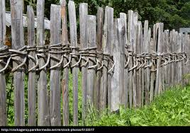 old wooden fence in south tyrol stock