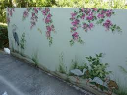 Egrets And Ibis Decorate Are The Subject Of This Tropical Outside Mural Garden Mural Garden Fence Art Garden Wall Art