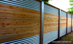Hybrid Fence With Galvanized Steel Aluminum And Cedar That We Built For Mrs Lecompte In Laval Backyard Fences Corrugated Metal Fence Backyard