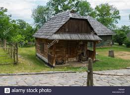 A Small Wooden House Surrounded By A Wicker Small Fence For Your Design Stock Photo Alamy