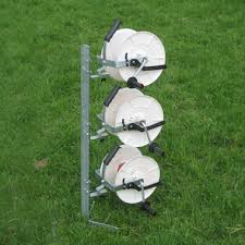 A Fencing Reel Kit With Geared Reels Support Stand