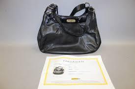 black leather coach purse with coa
