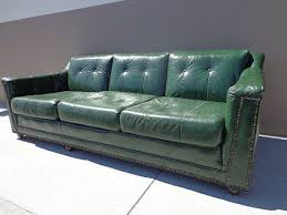 green leather sofa couch brass tacks
