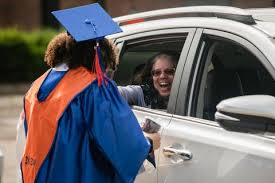Photos: Curbside diploma service for Chicago high schoolers graduating in  the age of COVID-19 - Chicago Sun-Times