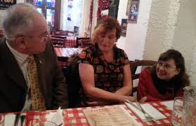 Authors Ivan Morris, Phil Noone and Siobhan Mungovan deep in conversation.  | Christmas party, Photo, Author