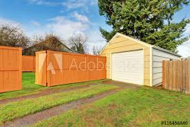 Small Beige Detached Garage At The Fenced Backyard Buy This Stock Photo And Explore Similar Images At Adobe Stock Adobe Stock