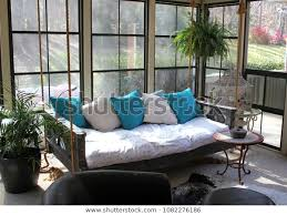 hanging swinging bed glassed outdoor