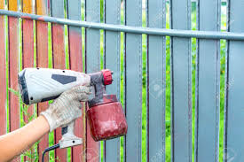 Painting Metal Fence Spray Man Paints A Fence With A Paint Sprayer Stock Photo Picture And Royalty Free Image Image 131317728