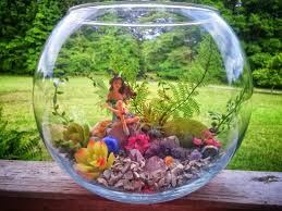 small fairy garden in a fish bowl