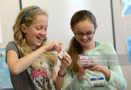 Maddie Ball, left and fellow sixth grader Abby Baker work with ...