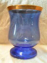 blue glass gold trim candle holder