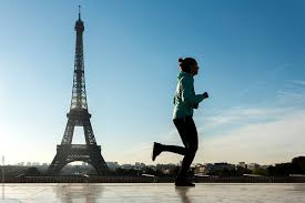 woman running on the eiffel tower