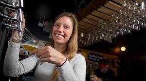 Natalie Johnson, partner at Paradigm, keeps busy by tending bar and running  the Bottle Bracket wine startup - Bizwomen