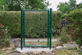 Installing A New Green Mesh Metal Garden Gate And Fence Around Stock Photo Picture And Royalty Free Image Image 118863249