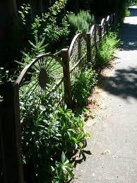 Wagon Wheel Fence Garden Whimsy Backyard Garden Design