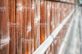Kyoto Japan Residential Area With Closeup Of Bamboo Wooden Fence With Red Orange Brown Color By Sidewalk Stock Photo Download Image Now Istock