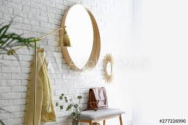 room interior with round mirror hanging