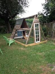 Coop Made From Old Swing Set Used Reclaimed Wood From Old Fence Panels And Two Old Windows The Girls Love It Chicken Coop Diy Chicken Coop Chicken Diy