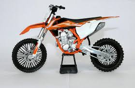 Amazon.com: New Ray KTM 450 SX-F Dirt Bike Orange and White Motorcycle  Model 1/10 57943: Toys & Games