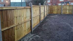 How To Install Concrete Fence Posts And Gravel Boards For A Panel Fence Diy Doctor