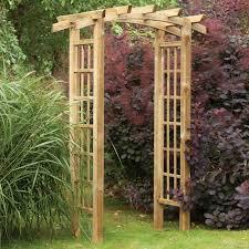 backyard with a garden arch trellis