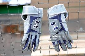 A Pair Of Under Armour Gloves Hang On The Dugout Fence Before The News Photo Getty Images