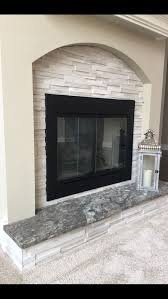 fireplace using granite and stone