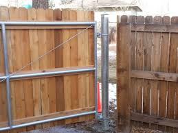 Close Up View Of Wood To Steel Gate With 4 In Post Residential Industrial Fencing Company In Denver Co