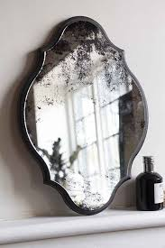 vintage style foxed wall mirror