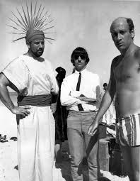 Ringo Starr pictured centre with film director Richard Lester (right)  during filming of the Beatles film Help! in the Bahamas in February 1965