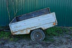 Iron Old Car Trailer On The Road Near The Fence Stock Photo Image Of Tool Wheels 105736474