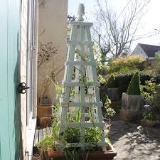 painting wood paint on garden obelisks