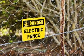 Free Photo Danger Sign Hung From The Electric Fence