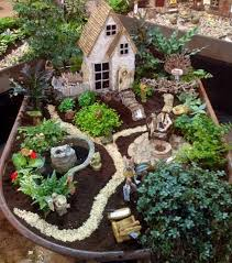 fairy garden in a wheelbarrow from