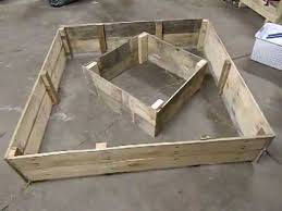 recycled wooden pallet raised bed