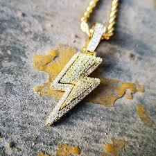 iced lightning bolt pendant in gold
