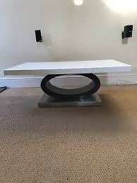 brand new saturn coffee table with high