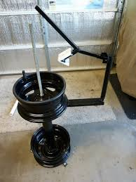 tire changing stand and wheel balancer