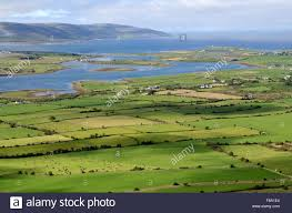 View from Abby Hill over green fields farmland towards Galway Bay ...