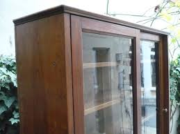 glass cabinet with sliding doors 1920s