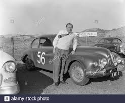 Tulpenrallye. Finished second: J.W.E. Banks- A. Meredith Owens with a  Bristol (startno. 56). [Here probably poses J.W.E. Banks] Date: May 7, 1955  Location: Noordwijk Keywords: Autorally, Motorsport, Sports Person Name:  Banks, J.W.E.