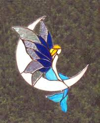 mermaid on moon stained glass stained