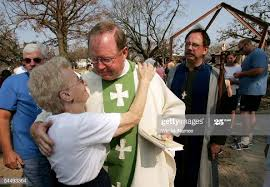 Rev. Harold Roberts hugs parishioner Melba Smith at the conclusion ...