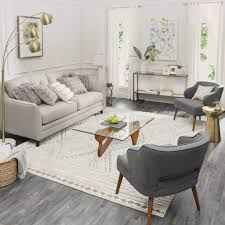 arrange furniture around an area rug