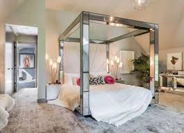 mirrored canopy four post bed without