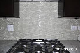 glass mosaic vs marble tiles kitchen