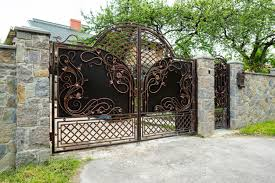 Premium Photo Forged Metal Gates With Patterns And A Gate In A Stone Fence