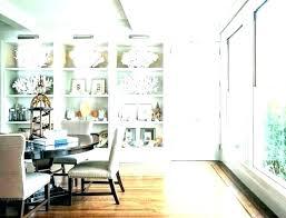 floating glass shelves in dining room