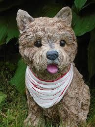 concrete statue cairn terrier dog